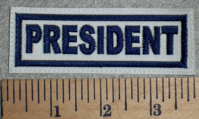 2698 L - President - White Background - Blue Lettering - Embroidery Patch