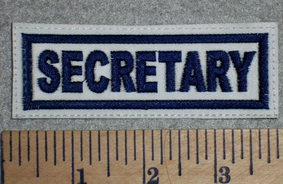 2699 L - Secretary - White Background - Blue Lettering - Embroidery Patch