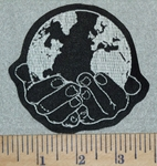 3128 L -  World In Hands - Embroidery Patch