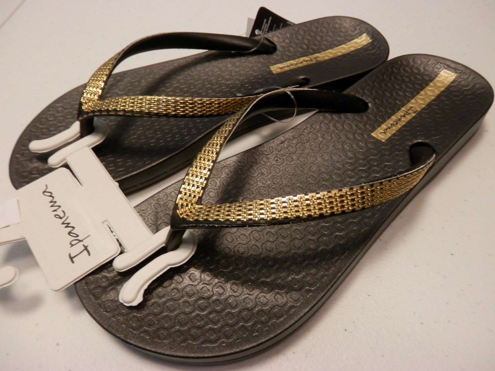 651aed3d54f8 Ipanema Ana Metallic Flip Flops in Black and Gold