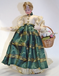 Wax Girl in Ivory Dress with Green Pinafore and Braided Hair by Margarete & Leonore Leidel in Iffeldorf