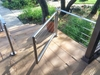 An opened stainless steel cable railing gate