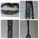 1 brown with turquoise flowers creme border jacquard belt with fringe 62 inch long.