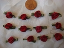 1 Dozen pc red flower w/ green leaf applique 7/8  wide