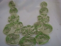 1 piece of chiffon Ivory with lime green and with tulle on the back applique 10 1/2 w L9
