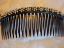 1 pr black hair comb with silver floral design