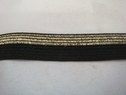 1 roll of 100 yards of black with gold glitter foe/fold over elastic trim 5/8 w