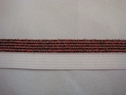 1 roll of 100 yards of white with red glitter foe/fold over elastic trim 5/8 w