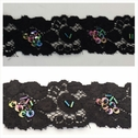 Black iridescent cupped sequins and bugle floral stretch lace trim 1 1/2 inches wide.