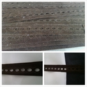 Brown insert faux suede trim 3/4 inches wide.