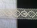 Natural crochet clunny trim. 1 1/2 inches wide.