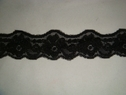 Black matte and embossed floral stretch lace trim. 1 1/2 W  S4-4