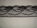 Black scalloped floral lace trim. 2 1/2 W. L8-6