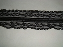 Black stretch lace trim.  1 1/2 W S5-5