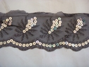 Black tulle with silver flat sequins trim. 3 1/4  inch w
