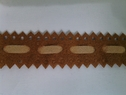 Camel and creme faux suede trim. 3/4 inches wide.