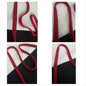 Dark red cotton knitted flat cord trim 7/16 inches wide.