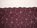 Eggplant color 3-D embossed floral scalloped fabric. 23-24W