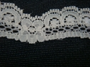 Ivory color scalloped lace trim. 3/4 w L1-3
