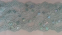 Light turquoise stretch flat sequins double scalloped floral lace trim. 3 1/4 W L10 box 1