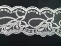 Off white embroidered tulle trim. 2 inches wide