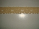 Tan color stretch lace trim. 1 W S1-8