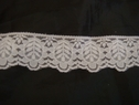 White scalloped lace trim. 1 1/2 w L8-7