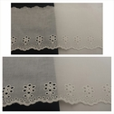 Off white double scalloped embroidered eyelet trim 4 inch wide.