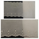 Off white double scalloped embroidered floral design eyelet trim 5 inch wide.