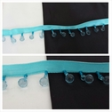 Turquoise satin ribbon beaded fringe trim with pale blue beads 7/8 inches long.