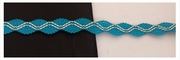 Turquoise with white elastic embroidered stretch rick rack ribbon 3/8 inches wide.