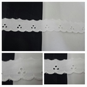 White double scalloped embroidered eyelet trim 1 inch wide.