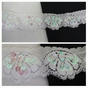 White double scalloped flat iridescent sequin stretch lace trim 1 5/8 inches wide.