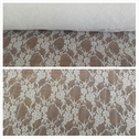White floral design 4 way stretch lace fabric 60 inch long.