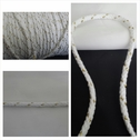 White with gold round cotton twisted cord string 1/4 inch wide.
