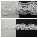 White with pearls and ivory cupped sequins stretch lace trim 1 5/8 inches wide.