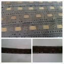 Brown with camel insert foral faux suede trim. 1 inch wide