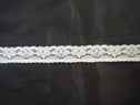 Narrow floral design white stretch lace 1/2 in w S1 Box