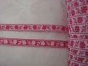 Jacquard ribbon fuchsia flower white background