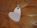 Heart shaped sterling silver pendant stamped 925