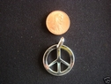 Peace sign sterling silver pendant stamped 925