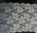 White stretch leaf design double scalloped lace trim 5 1/4. S6-8