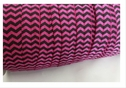 wholesale roll of 100 yards of azalea with black chevron fold over elastic trim 5/8 inches wide.