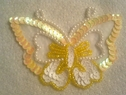 yellow white beaded air on butterfly applique
