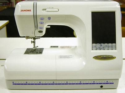 Janome Memory Craft 10001 Computerized Sewing Quilting and Embroidery Machine