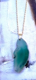 Agate necklace on a golden chain turquoises