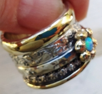 Blue opal on a flower spinner ring silver gold