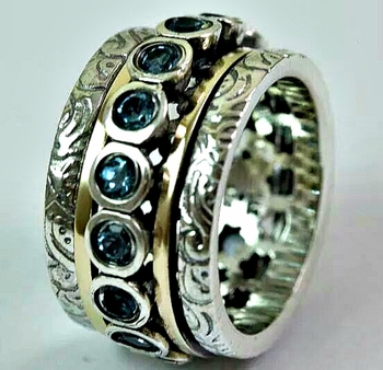 Israeli jewelry Spinner ring Blue Topaz silver and gold