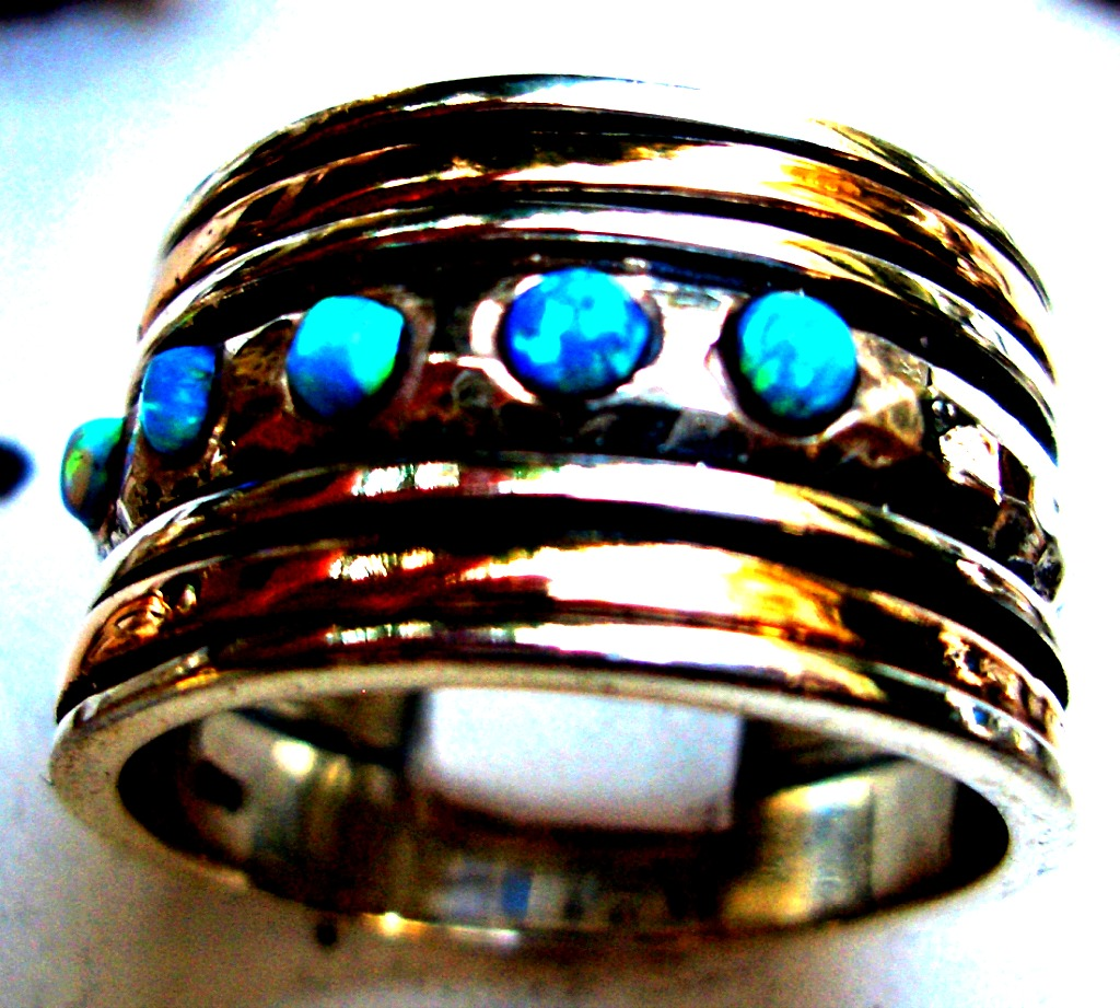 Israeli silver and gold spinner ring set with opal stones
