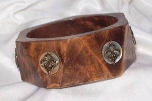 Dark Wooden Bangle with Mother-of-Pearl Disks and Fleur de Lis
